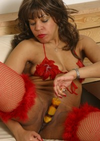 Black and sexy chick in stocking eating thick rod