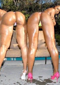Hot ebony babe duo gets pounded on the couch in this white cock threesome