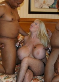 Huge fake tit Kayla sucks two big black cocks till they shoot their load on her.