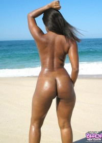 Hot black babe naked on the beach