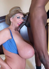 Black thug fucks Claudia Marie hard and then cums all over her great big fake titties