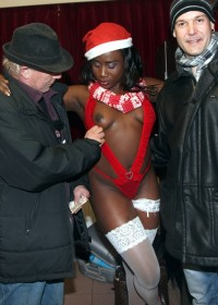 Black prostitute with a santa hat shagging her first client