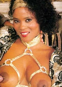 Classic Black Pornstars. Black dolls from the vintage porn tapes love to land the big black boobs on horny male faces.